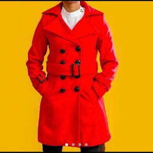 Knee length red collared trench coat.